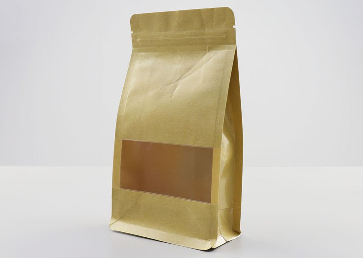 Brown kraft paper quad seal pouch with window