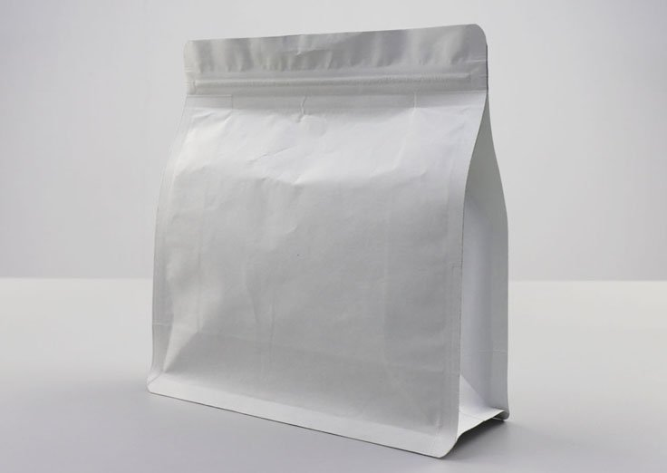 White kraft paper quad seal pouch with resealable zipper