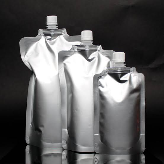 Stacked liquid pouches on display