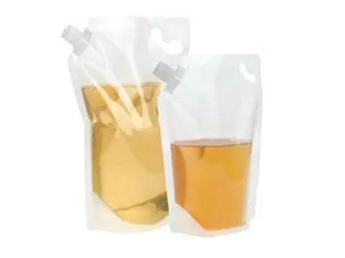 corner mounted spout pouch closure